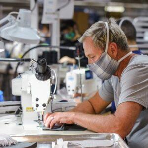 Person sews fabric mask to help prevent COVID-19 spread